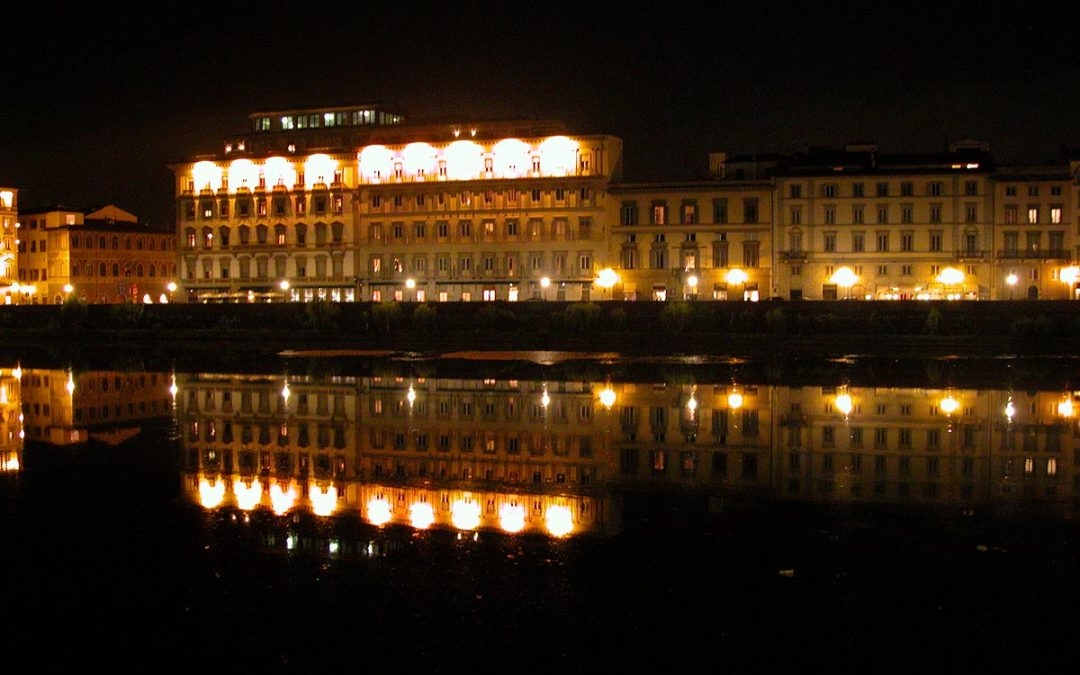 Westin Excelsior hotel, Florence, Italy, reflected in the River Arno at night